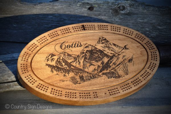 mountain-with-bear-cribbage-board